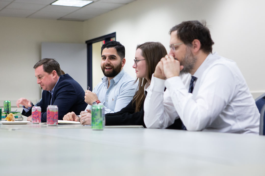 Philosophy majors, minors and alumni sit at a table at a February 2020 career planning event.